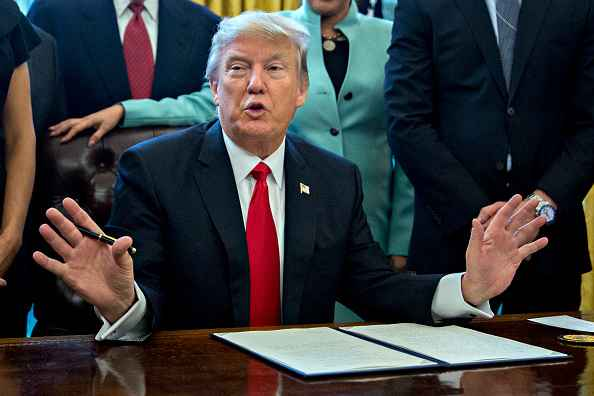President Trump Signs Executive Order In Oval Office Of The White House