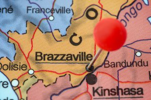 Close-up of a red pushpin in a map of Brazzaville, Republic of the Congo.