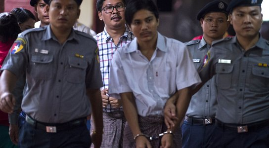 Detained Myanmar journalists Kyaw Soe Oo (front) and Wa Lone (back) are escorted by police to a courtroom for on going trial in Yangon on August 20, 2018.