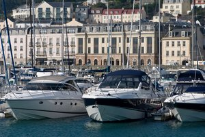 Financial centre and motor boats in marina, St Peter Port, Guernsey.