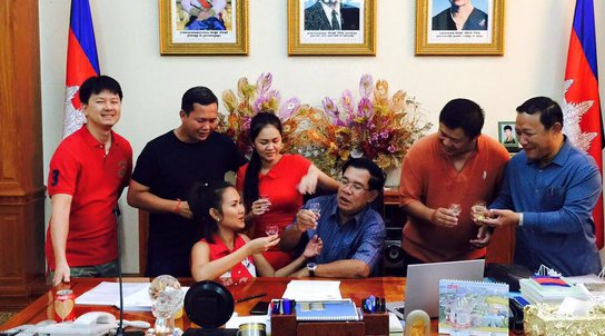 Hun Sen posts a picture of him and his children and chidlren-in-law in his office. Posted in response to the launch of Hostile Takeover on 7th July.