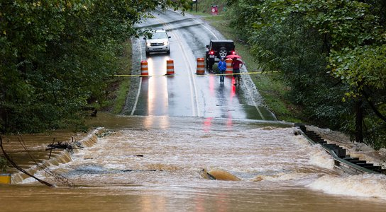 Waxhaw, North Carolina - September 16, 2018: Motorists inspect a road flooded by rain from Hurricane Florence Credit: Jeremy Warner/ Shutterstock
