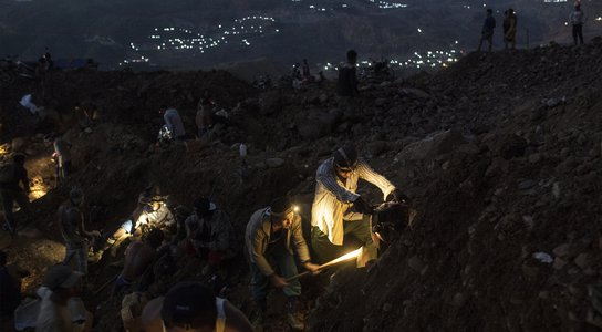 At dusk, teams of small-scale miners working at a non-operational company mining site near Sa-Pot Maw, Hpakant, October 22, 2016.