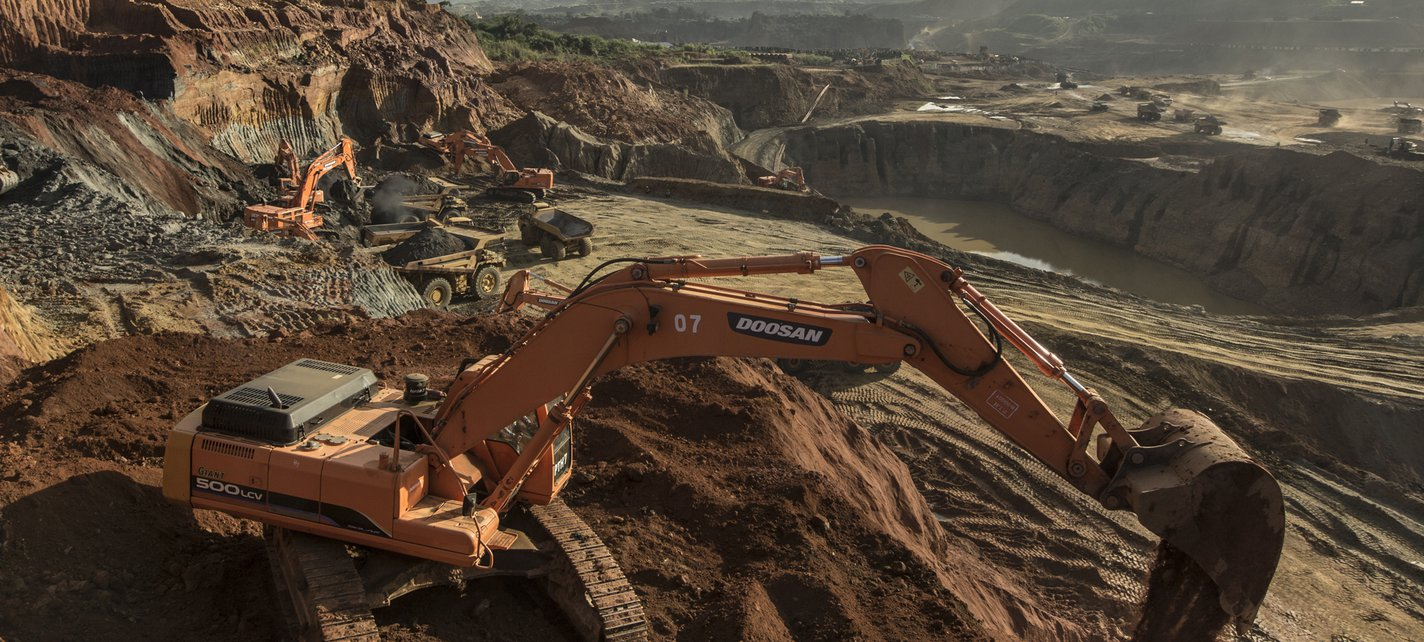 A backhoe working at Pho Thar Htoo company mining site in Ngo Pin where Ever Winner, Pho Thar Htoo, Mya U Yin, Yadanar Yaung Chi and Wai comapanies are opearating, Hpakant, October 23, 2016., Hpakant, October 23, 2016.