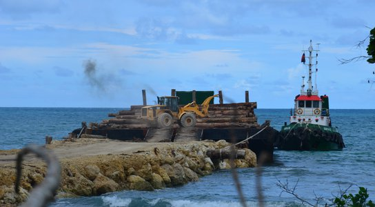 Logs being loaded for export, West Sepik Province, PNG, October 2019.