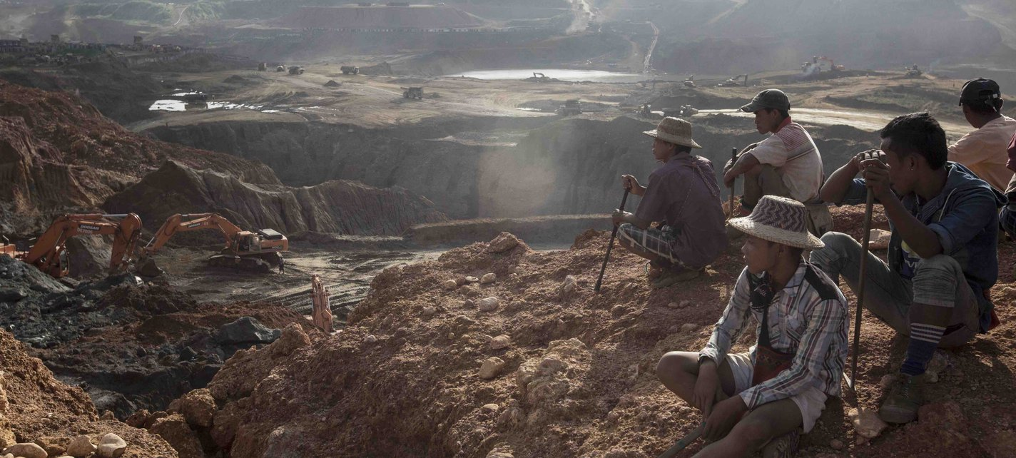 Freelance Yemasae miners sit on top of a hill near the Ngo Pin