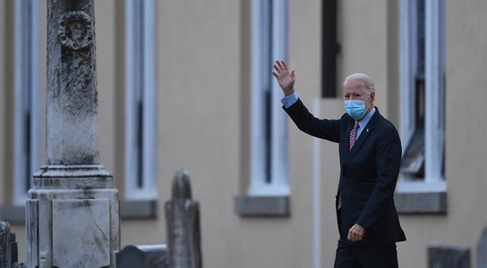 US President-elect Joe Biden waves as he leaves St. Joseph-ANGELA WEISSAFP via Getty Images.jpg