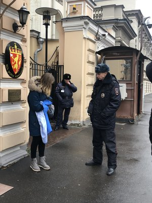 A young climate activist is confronted by authorities in Moscow, Russia