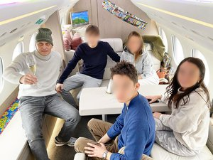 tinkov-family-on-jet.png